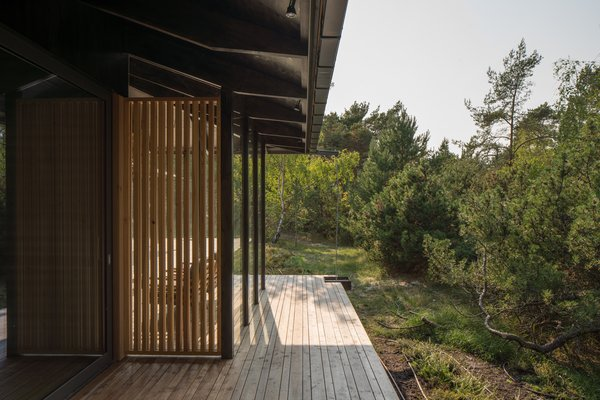 While the trees help to block the wind coming in off the sea, it can be quite strong, so the clients wanted the outdoor rooms to be protected. Louvers help to shelter the outdoor dining room.