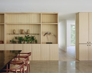 The living and dining rooms have custom built-in cabinetry by Alula Woodworks.