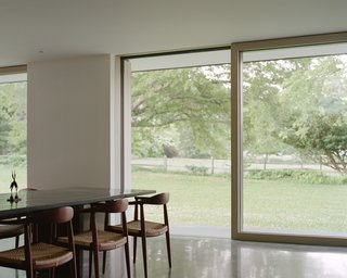 The owners did not want window treatments that would obscure the views, so motorized privacy shades and insect screens were installed on the exterior. The polished concrete floor slab helps cool the home in the summer and retain heat in the winter.
