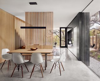 The goal for the first floor was to embrace the shade provided by the mature trees, create a rich material moment, and incorporate all of the storage that the family would need.