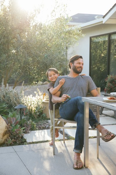 Clint and one of his three children hang out on the spacious patio that he added in the backyard.