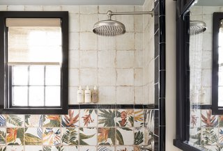 The showers are clad in ceramic tiles painted to celebrate native plants and flowers.