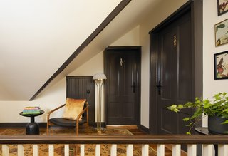 Throughout the hotel, moldings are painted to celebrate the building's original architectural details.
