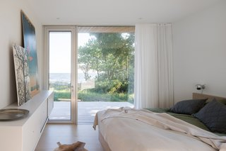 The primary bedroom faces the sea and has direct access to the large deck.