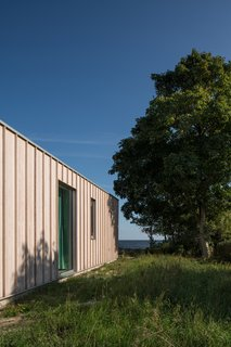 """Sundberg used materials, which include concrete and zinc in addition to larch, that were as close to their natural and untreated form as possible. """"It is the right thing to do here,"""" he says. """"We don't want our design to pretend to be something it is not."""""""