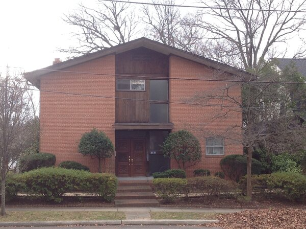 Before: The home had a pink brick exterior, with minimal windows on the facade.