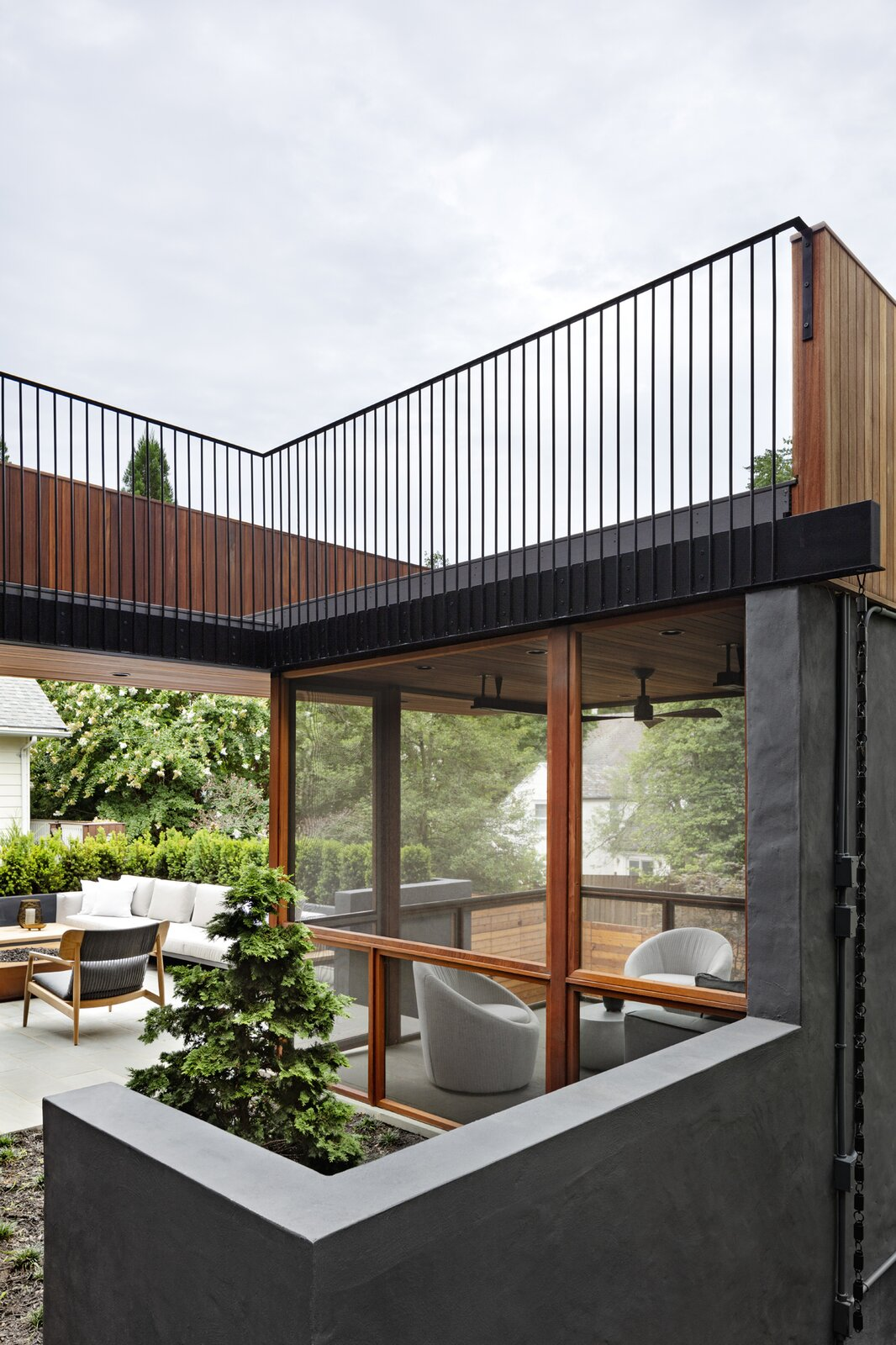 Stephenson House by Assembledge+ and Fowlkes Studio terrace and screened porch