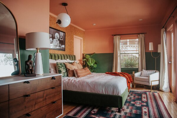 """Mamrie and Thomas DIY'ed the entire apartment. """"I am used to painting,"""" says Thomas, """"but I was not emotionally prepared for the amount of trim in the bedroom."""" Cedarville, a pastel pink hue, and Green Bayou, both by Dunn-Edwards Paints, now cheer up the space."""