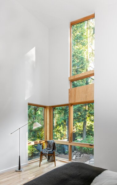A column of windows takes advantage of the double-height ceiling in the expanded primary bedroom, which sits above the yoga studio.