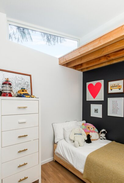 Raising the roof allowed for higher ceilings in the kids' rooms and created an additional loft that they can use as a play space.