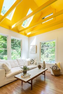 After: The second bedroom is now a sunroom and TV lounge, and Michelle's favorite space in the home.