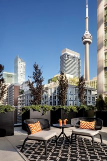 The Bisha Suite living room feeds onto a private, outdoor terrace.