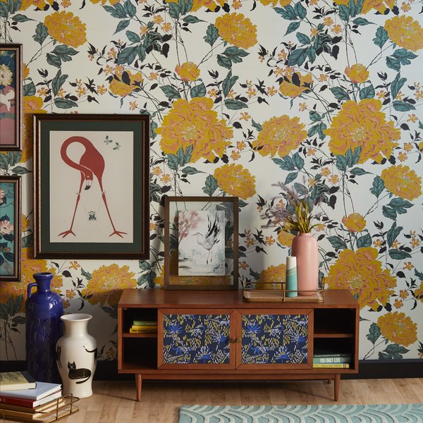 Yellow Vintage Floral Peel and Stick Wallpaper provides a flamboyant backdrop.