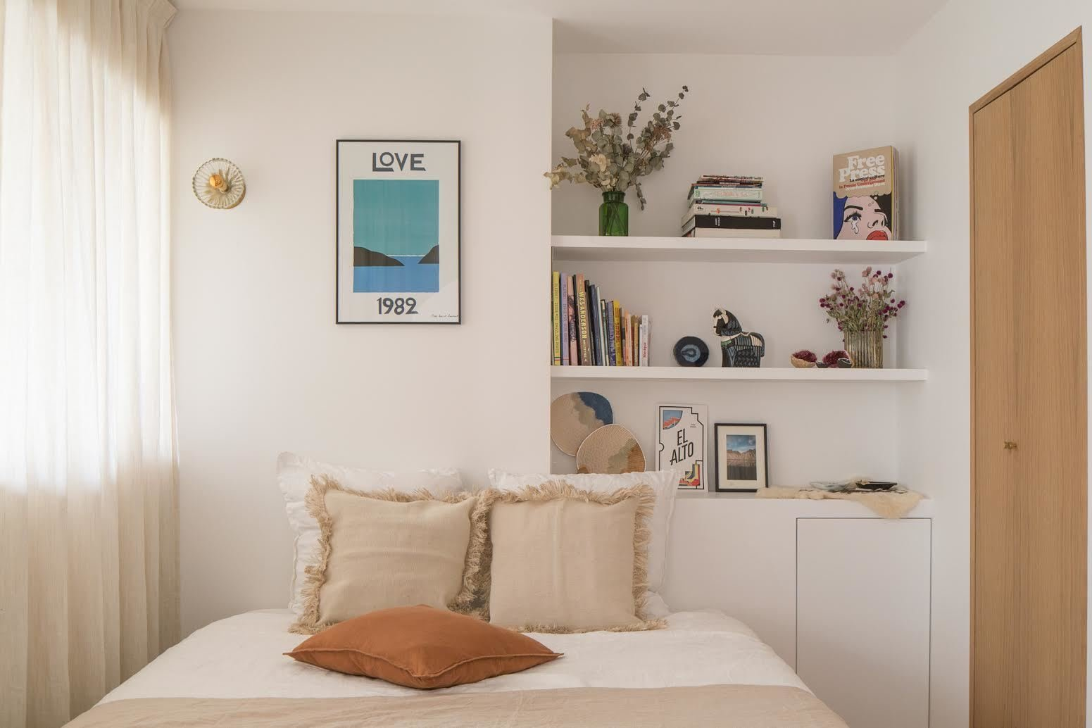 Something as simple as making your bed can make a small dwelling feel instantly larger and more spacious.  Photo 10 of 10 in How to Strike a Work/Life Balance in a Tiny Apartment, According to Design Experts