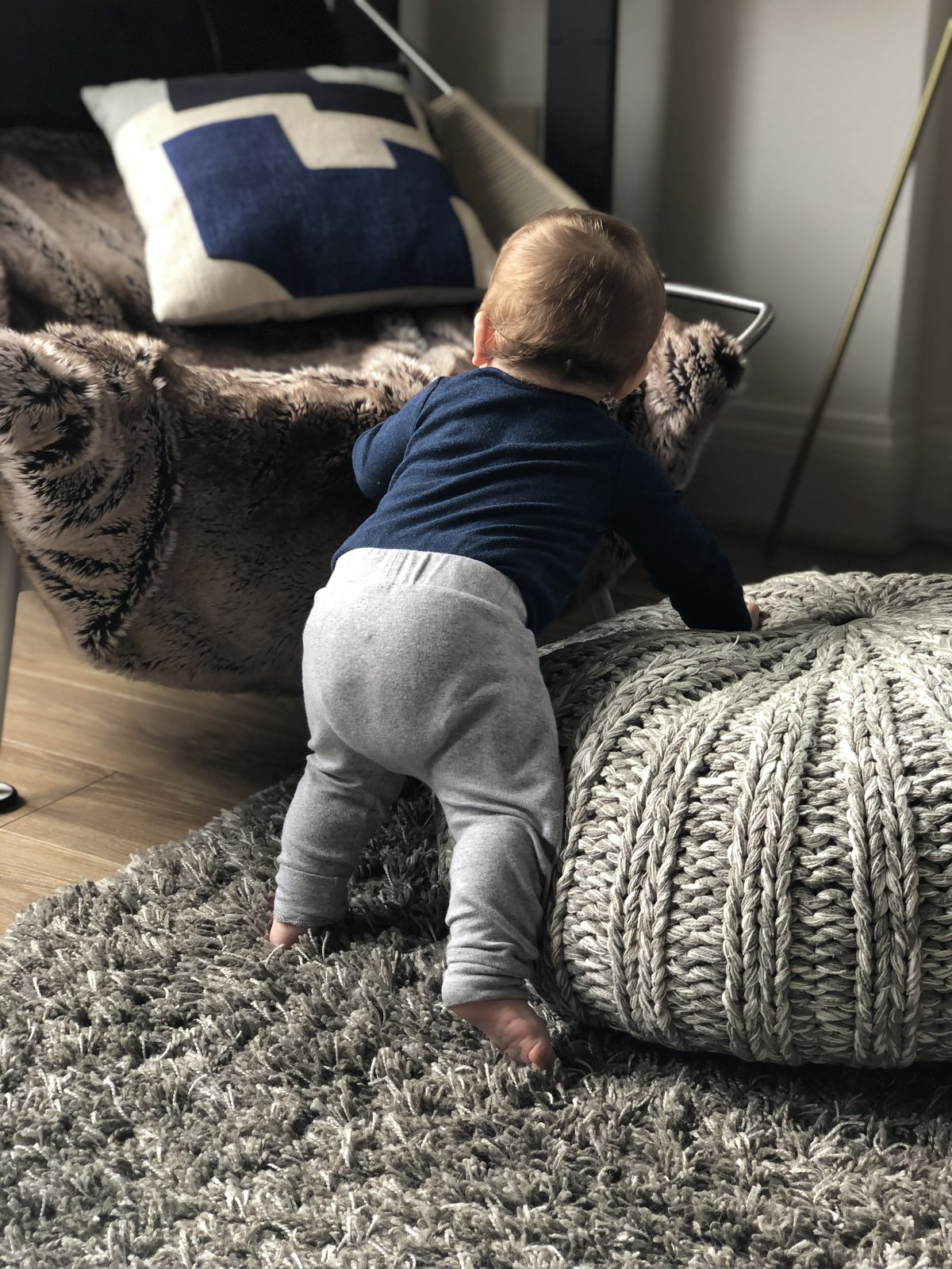 """Kara recently purchased a new chair as an investment piece: """"It's great for naps, Netflix, or for our eight-month-old to either chew on or practice his climbing.""""  Photo 11 of 17 in 8 Designers and Architects Share the Crucial Lessons They Learned From Dad"""
