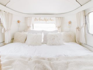 Welcoming and cozy, the bed is decadently spacious and is set upon hydraulics, which can easily be lifted to reveal even more hidden storage compartments.