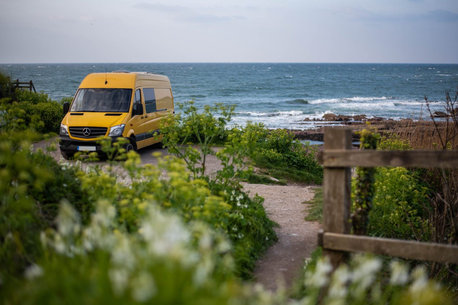 UK-based couple Charlie Low and Dale Comley converted this former DHL delivery van into a tiny home-on-wheels that would take them on new climbing adventures.  Photo 2 of 22 in Budget Breakdown: A Climbing Couple Turn a Delivery Van Into an Adventure Mobile for $8.5K