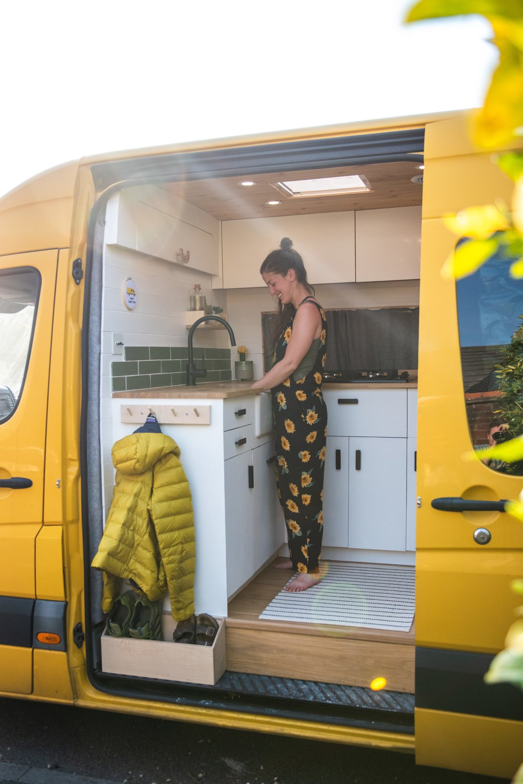"""A designated """"mudroom"""" at the door allows the couple to stow jackets and shoes.  Photo 17 of 22 in Budget Breakdown: A Climbing Couple Turn a Delivery Van Into an Adventure Mobile for $8.5K"""