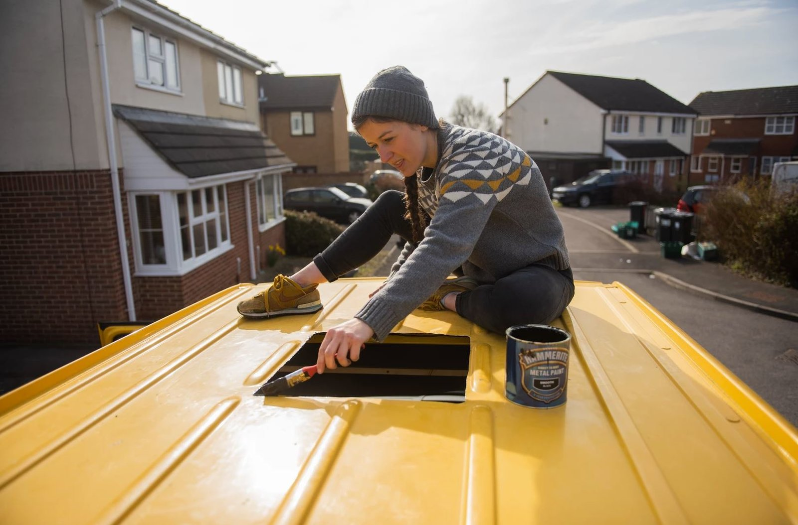Charlie preps the roof of the van for the new skylight.  Photo 5 of 22 in Budget Breakdown: A Climbing Couple Turn a Delivery Van Into an Adventure Mobile for $8.5K