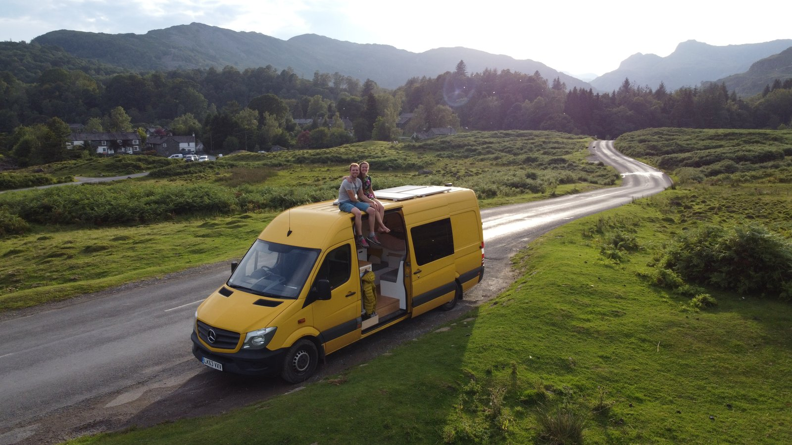 Charlie and Dale celebrate a trip to Langdale in the Lake District.  Photo 22 of 22 in Budget Breakdown: A Climbing Couple Turn a Delivery Van Into an Adventure Mobile for $8.5K