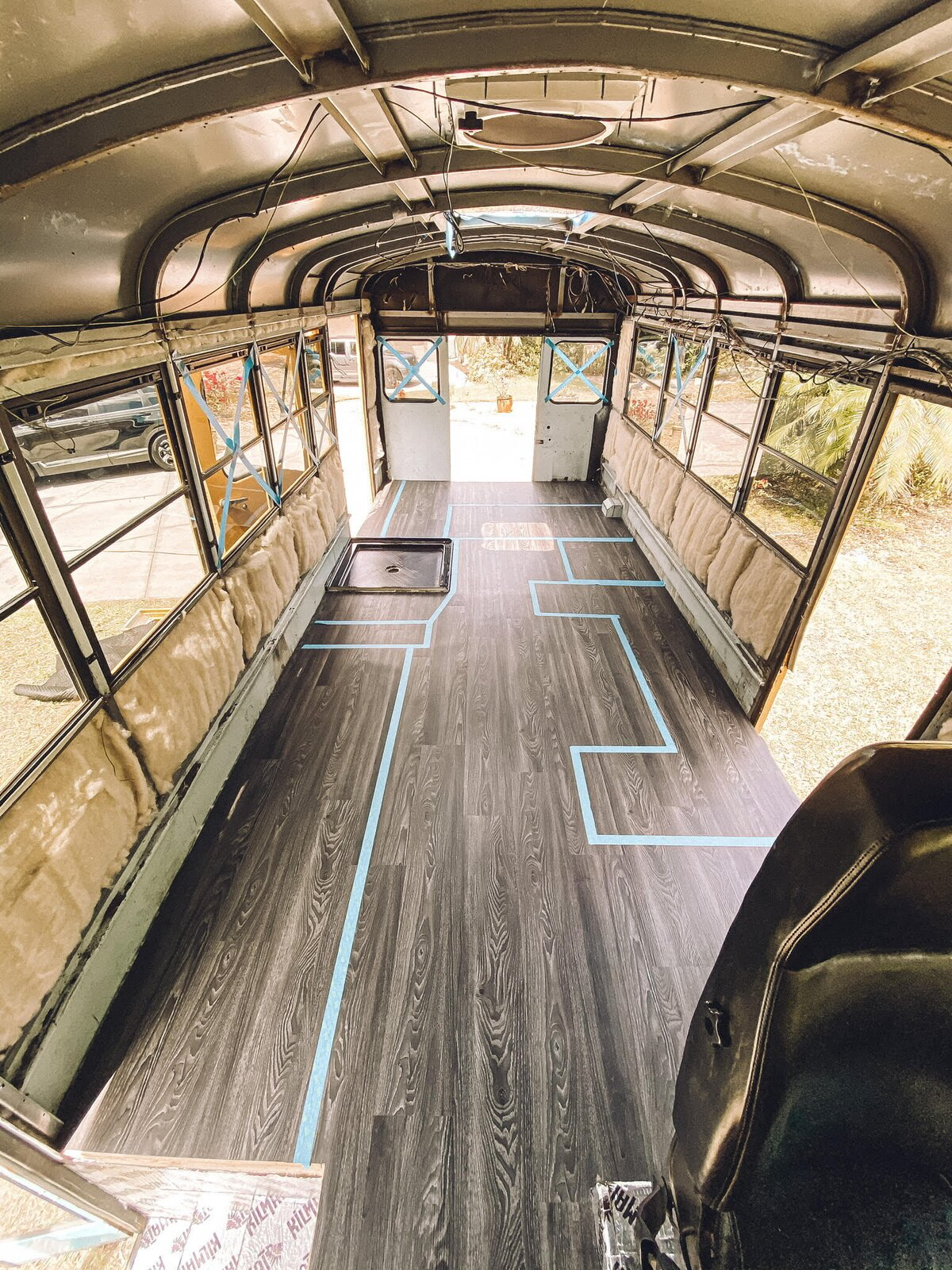 Buster the Bus vinyl floor and floor plan mapped out with painter's tape