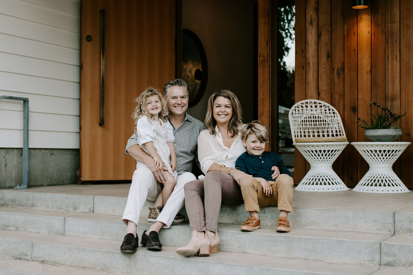 Holly Freres, principal at Portland, Oregon–based JHL Design, poses outside her home with her husband, David, and their two children, five-year-old Ellis and three-year-old Kennedy.  Photo 3 of 10 in 10 Designers and Architects Share What They're Most Thankful for in a Turbulent Year