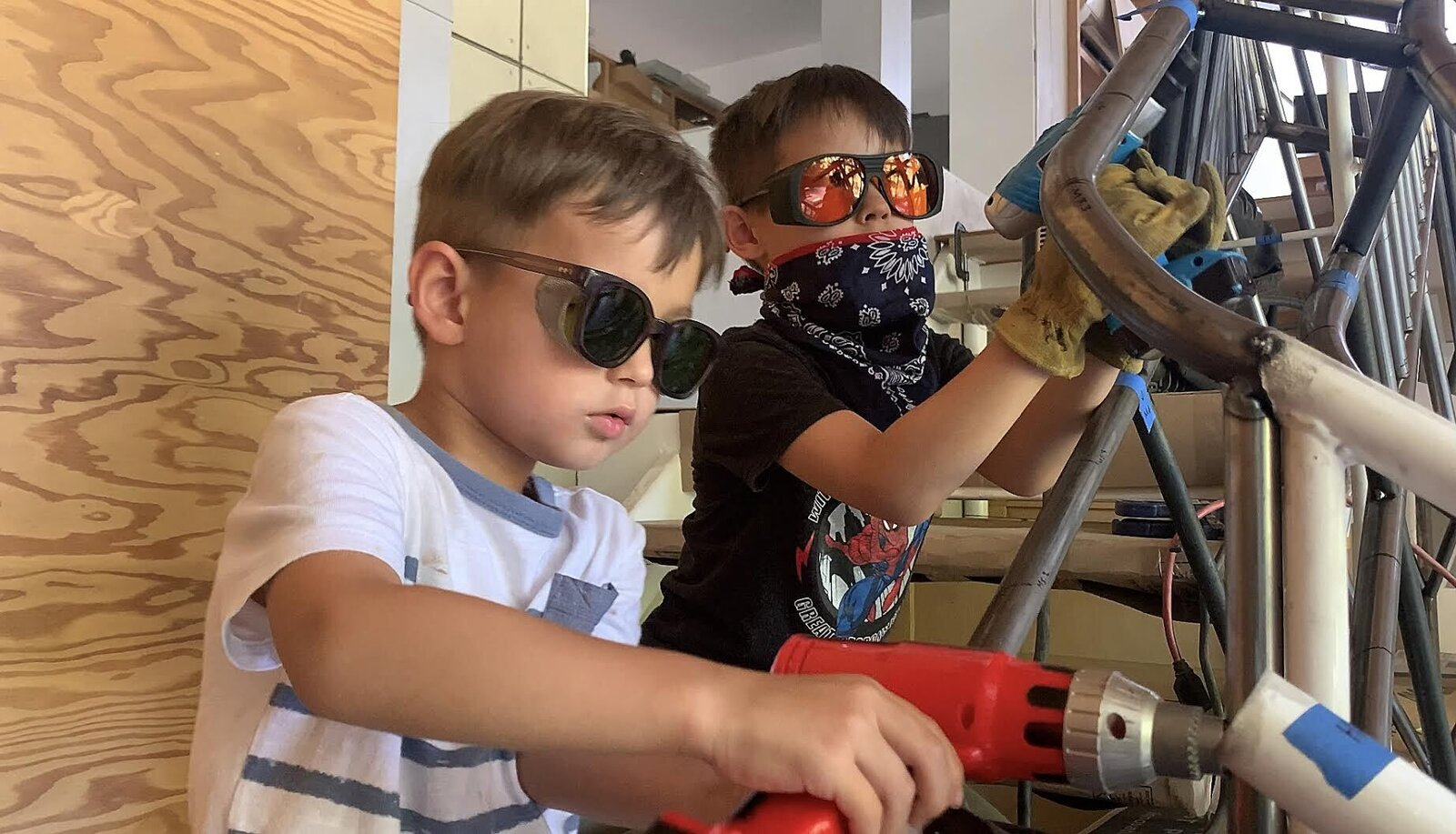 Jenny Wu and Dwayne Oyler of Los Angeles–based Oyler Wu Collaborative have two boys, Ariel (front) and Emery (back), who brought their toy tools to work on their family's studio space.  Photo 4 of 10 in 10 Designers and Architects Share What They're Most Thankful for in a Turbulent Year