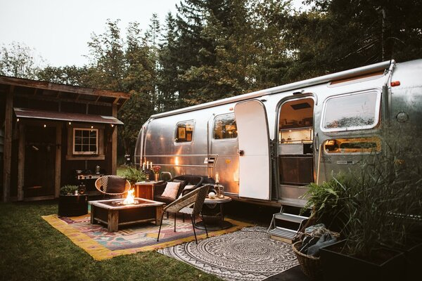 The family omitted a bathroom in the trailer and instead set the trailer beside an outhouse, giving them more living space in the Airstream.