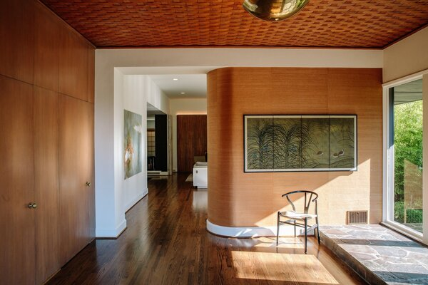 The home features a majestic curved zebrawood walls, which greets visitors in the foyer.