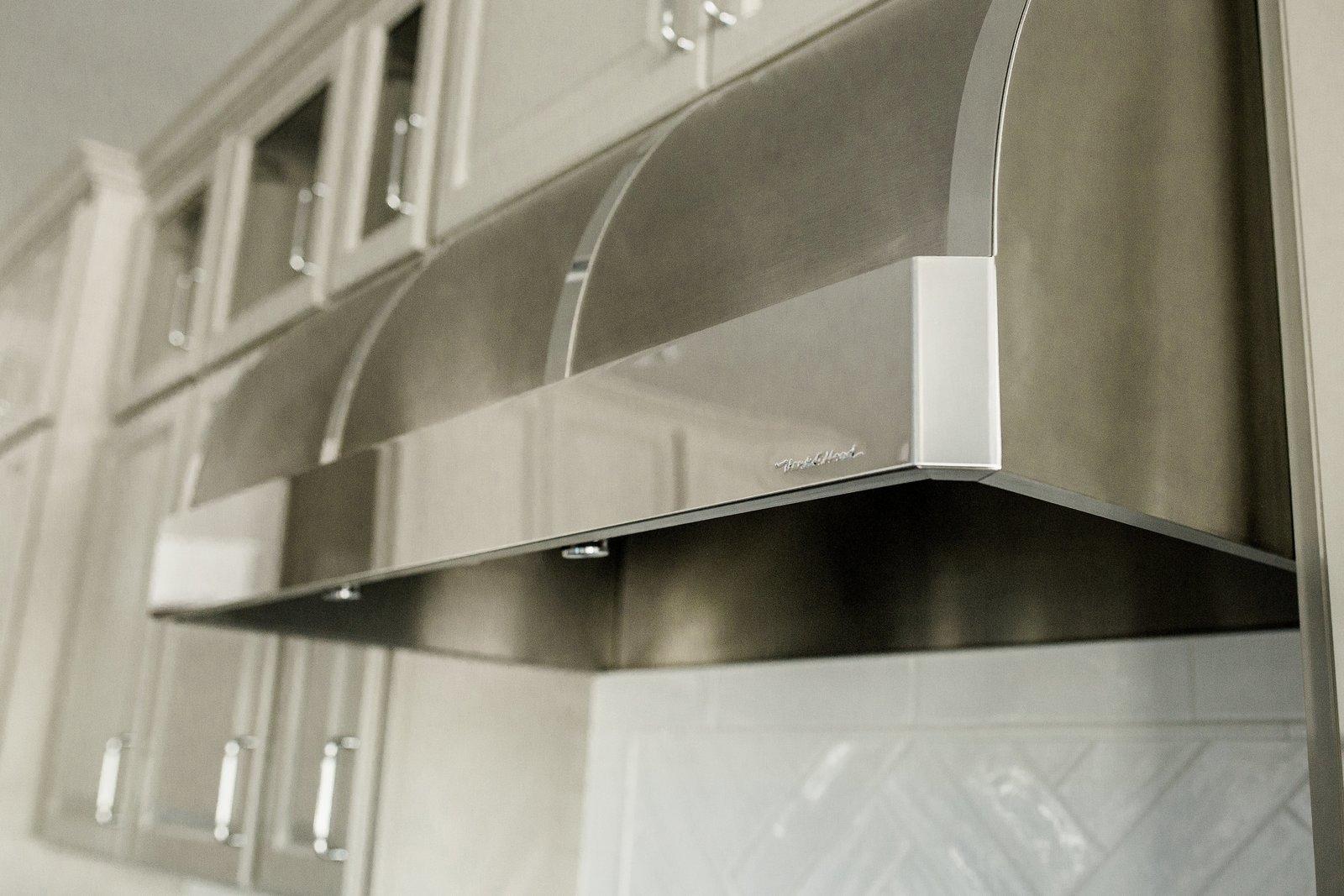 Subway Tile Backsplashe and Range Hood Kitchen  Hole in One