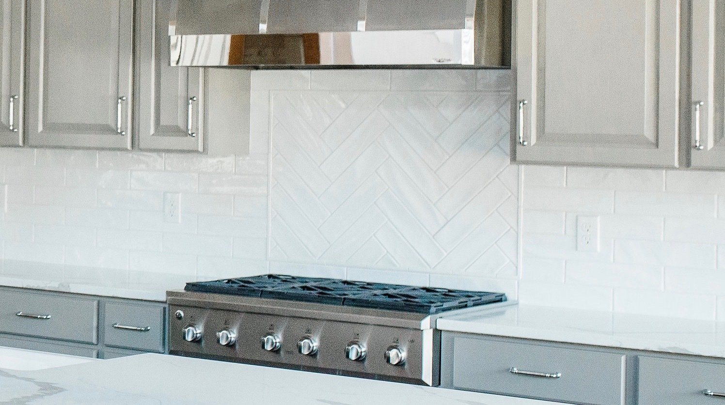Kitchen, Cooktops, Wood Cabinet, Range, and Engineered Quartz Counter Kitchen  Hole in One