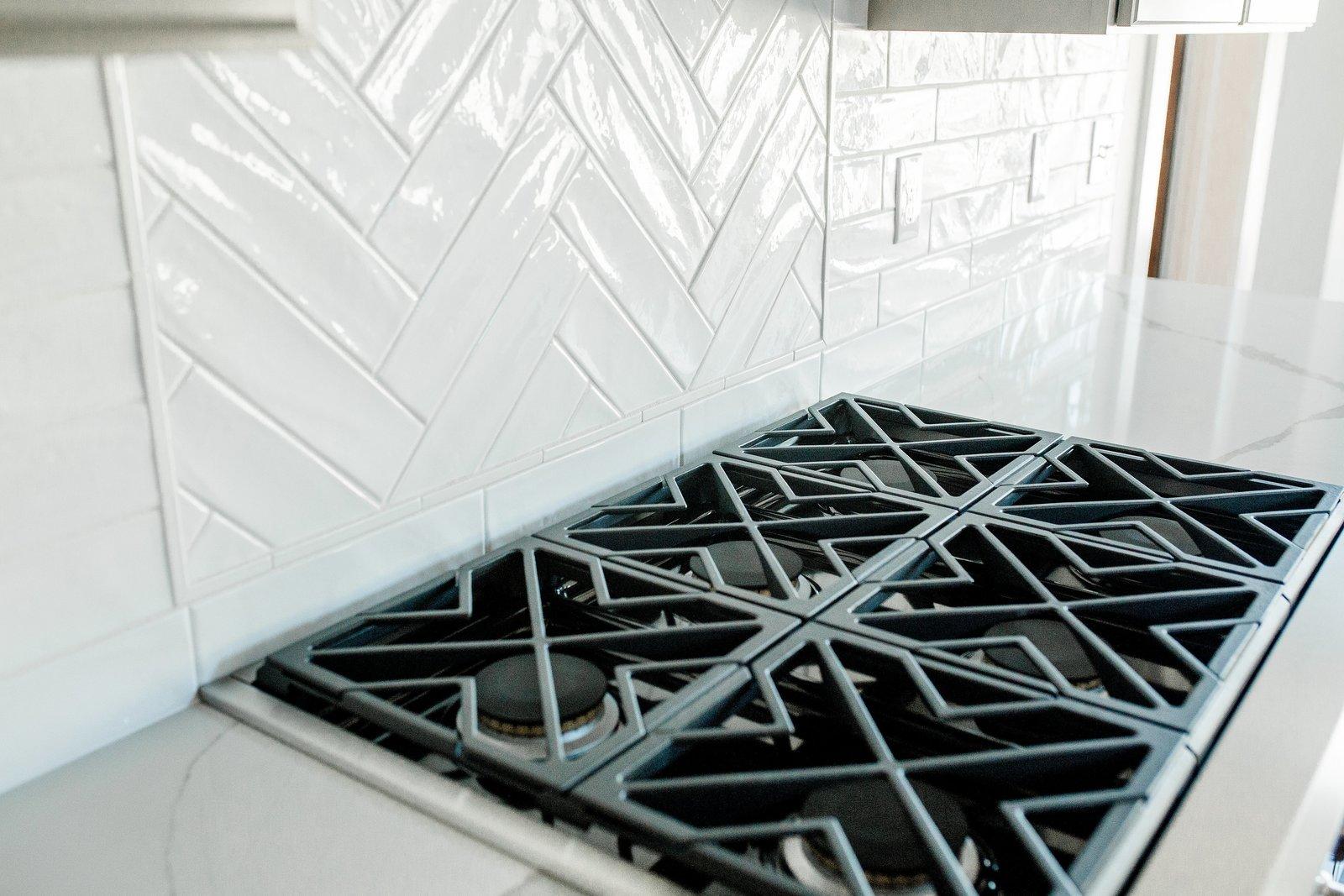 Engineered Quartz Counter, Kitchen, and Subway Tile Backsplashe Kitchen  Hole in One