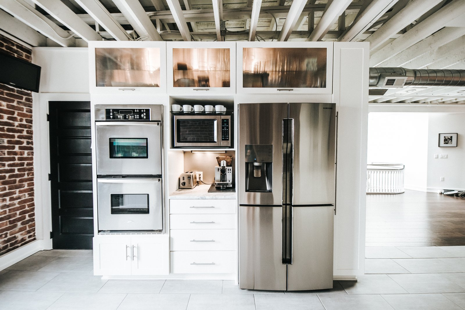 Kitchen, Wood Cabinet, Microwave, White Cabinet, Refrigerator, Wall Oven, Terrazzo Floor, and Marble Counter Kitchen Appliances  Frindle