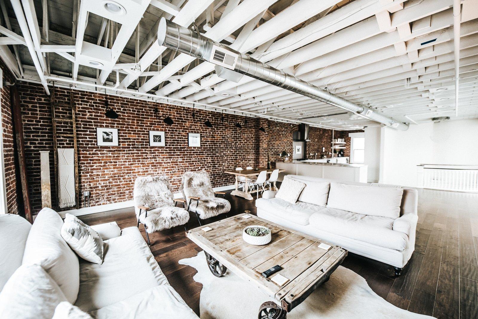 Living Room, Sofa, Coffee Tables, Chair, and Dark Hardwood Floor Living Area  Frindle