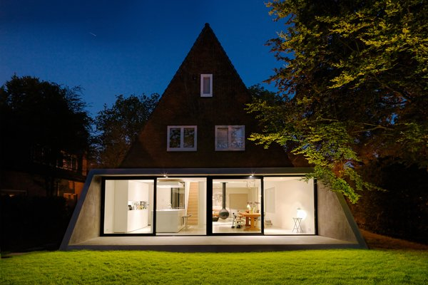 The ground floor is dedicated to an open-plan living and dining space that connects with the garden through the new extension, while the upper floors contain bedrooms and a rumpus room.