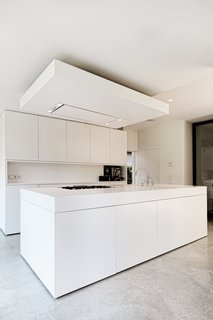 The sleek white-and-concrete interior fit-out provides a contemporary, open-plan living space for the young family.