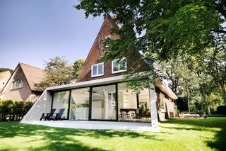 The SH House is named after the clients–Stefan and Hanne—and it realizes their dream of a home connected to the outdoors.