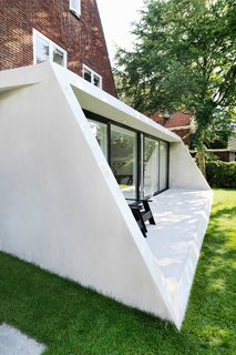 The contemporary concrete extension sits comfortably alongside the original brickwork.