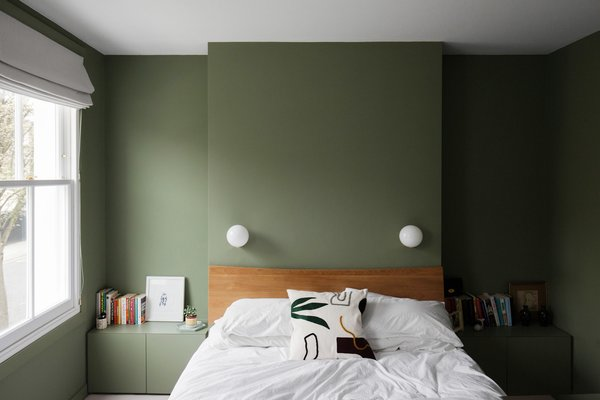 Olive is a calming shade of green that works well in bedrooms.