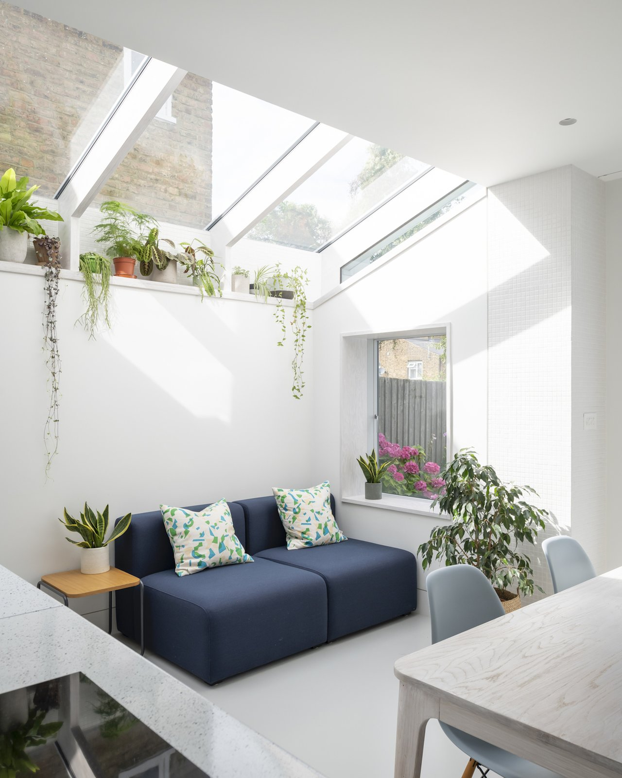 Living space with skylight and plant shelf at A Brockley Side by CAN