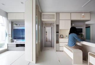 The living room and kitchen can be separated with a sliding partition to either create a fourth bedroom or simply divide the spaces if they are both in use.