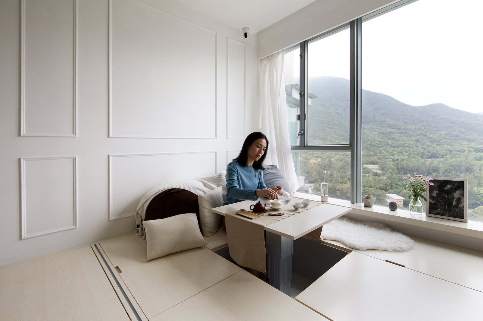The coffee table in the living room at Smart Zendo by Sim-Plex Design Studio.
