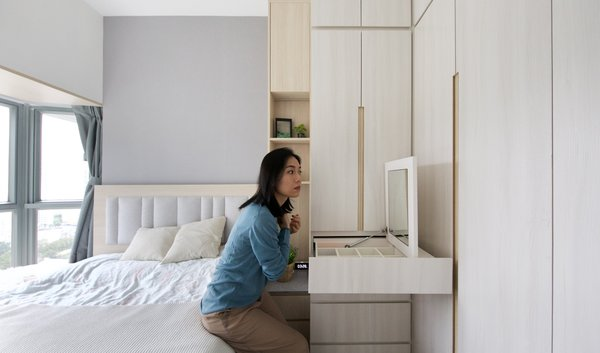 The inbuilt storage in the master bedroom includes a hidden make-up table. When it is set up, the edge of the bed can be used as a seat.