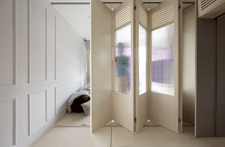 A folding partition can be used to separate part of the living room to create a fourth bedroom.