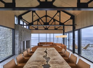 Set within an architectural village in Nova Scotia, Canada, MacKay-Lyons Sweetapple Architects' Smith House is a vacation home for an art collector couple. Comprising three pavilions looking out to the Atlantic Ocean, each building differs drastically in space and materials. For instance, the night pavilion reflects a stone cave with bedrooms, while the day pavilion's living and social spaces—including a hidden wine cellar under the kitchen—are reminiscent of a temple.