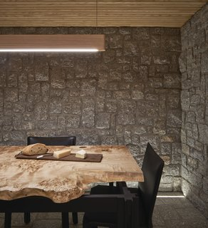 The granite wine cellar features a custom-designed timber-and-steel table.