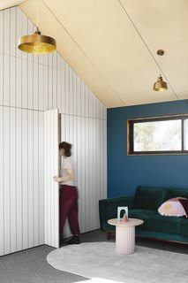 """The joinery in the upstairs living room conceals what the kids call """"Narnia doors."""" These doors lead to a space in the roof cavity where a bathroom will be built at a later date."""