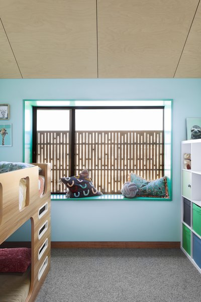 The feature walls in the children's bedrooms in the upstairs addition are painted using British Paints Waterflow 316.