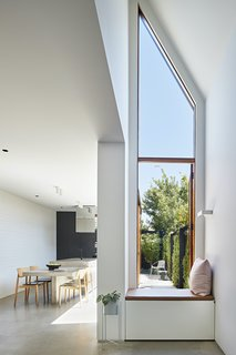 Each room in the home has views to one of two courtyards or the roof garden. A window seat in the living room embraces the transition between interior and exterior.