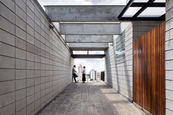 """The pergola on the """"promenade"""" entrance to the upper level residence frames views of the city and hints at the expansive balcony through which the home is entered."""
